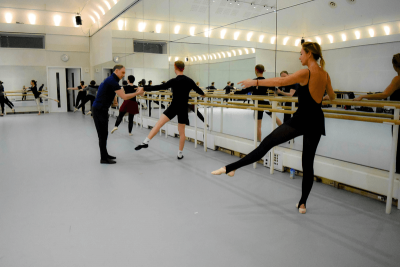 Everybody Ballet class students warm up at barre