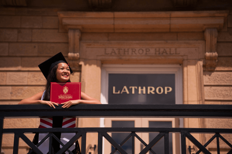 Girl holds Diploma at UW-Madison
