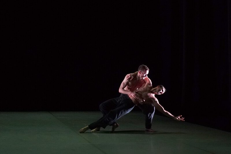 Two males dance a duet from Christopher Wheeldon's 'Us'