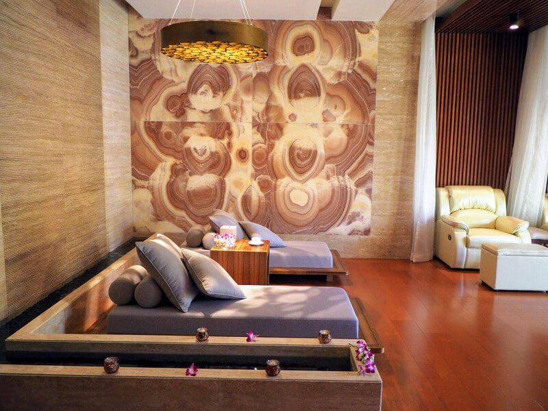 purple loungers on a cherry floor at Senses Health Club spa in Macau