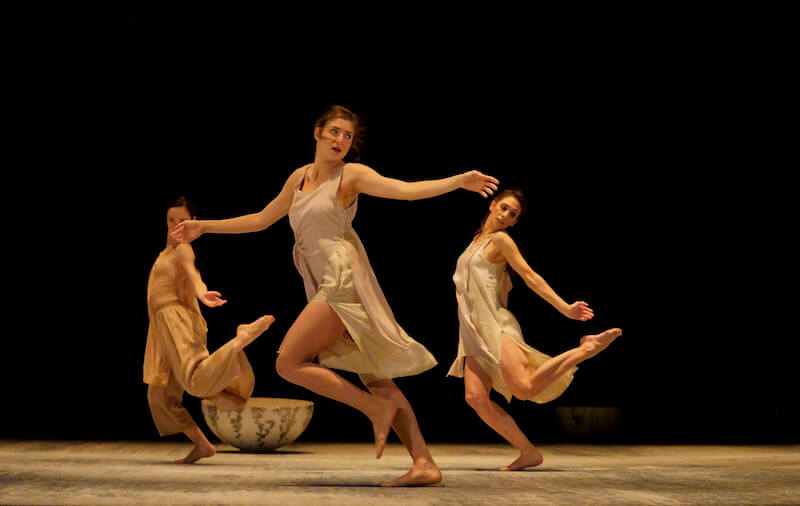 Dancers run off stage in Joy Alpuerto Ritter's new piece, 'UNDA'