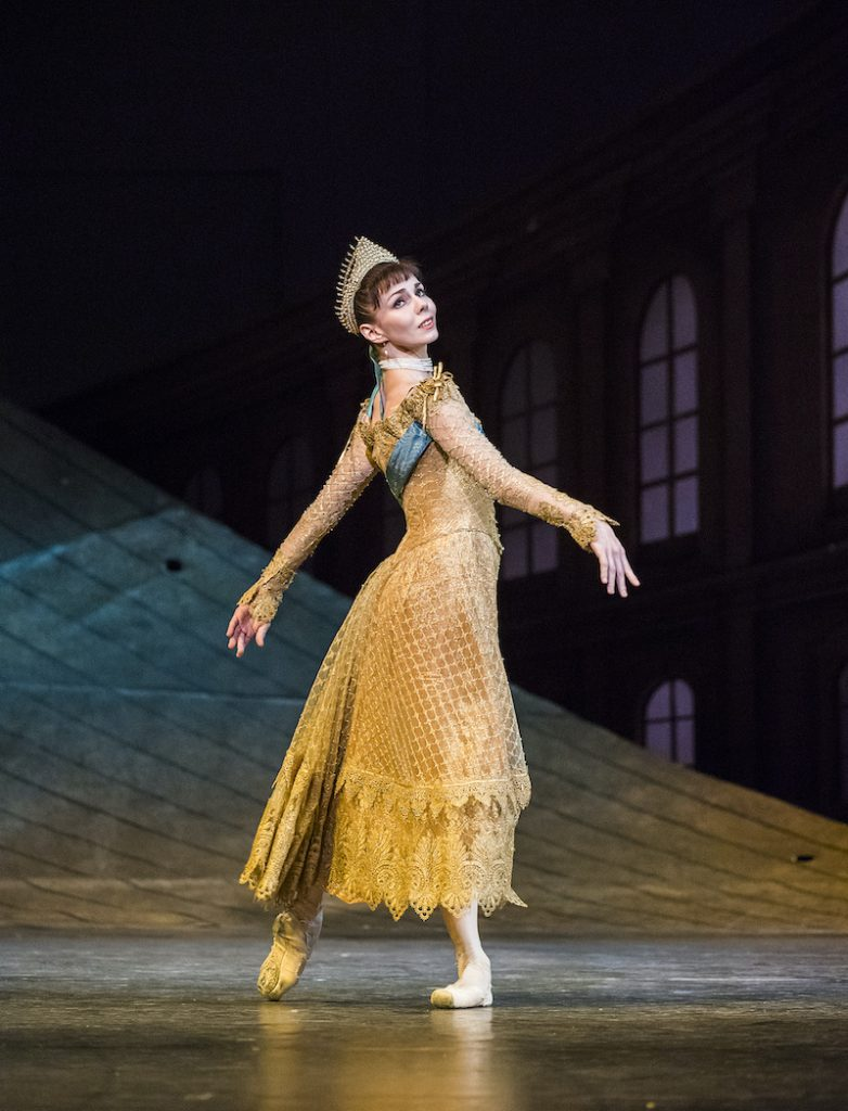 Anastasia wears a gold dress and tiara in the second act of the ballet