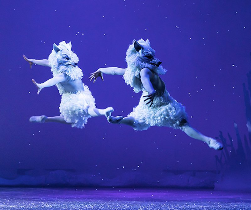 Snow wolves leap across the stage