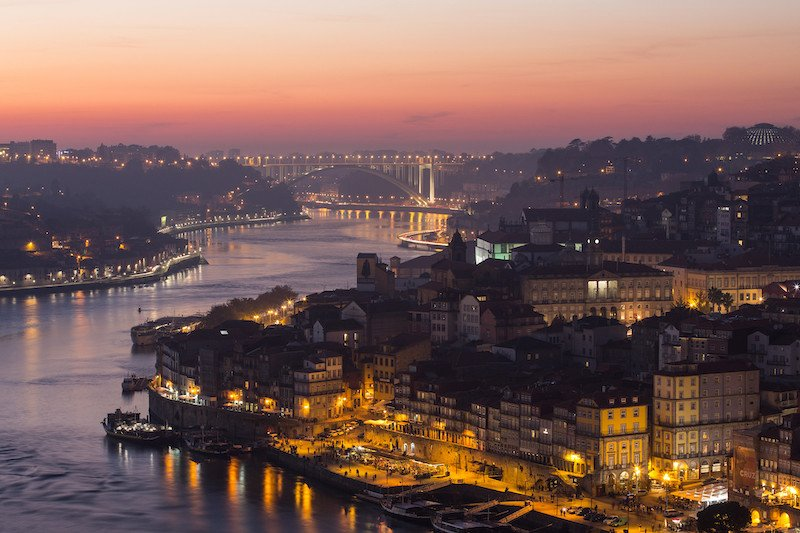 Porto, Portugal and the river lit up at nighttime