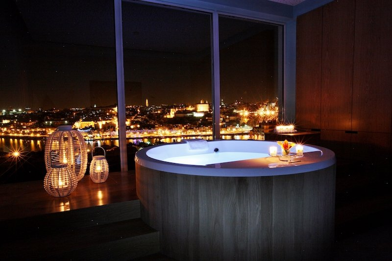 Spa tub at nghttime overlooking Porto and the Douro River