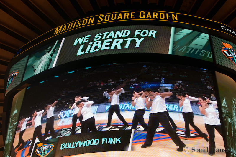 Bollywood dancers from Bollywood Funk NYC perform on Madison Square Garden jumbotron