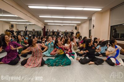 women sitting on the floor in an Indian dance class